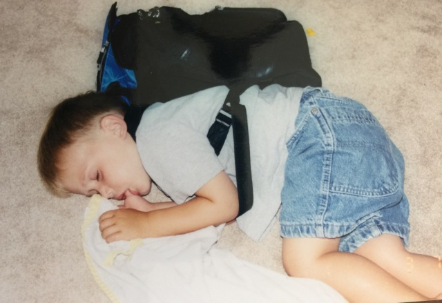 cameron asleep with back pack
