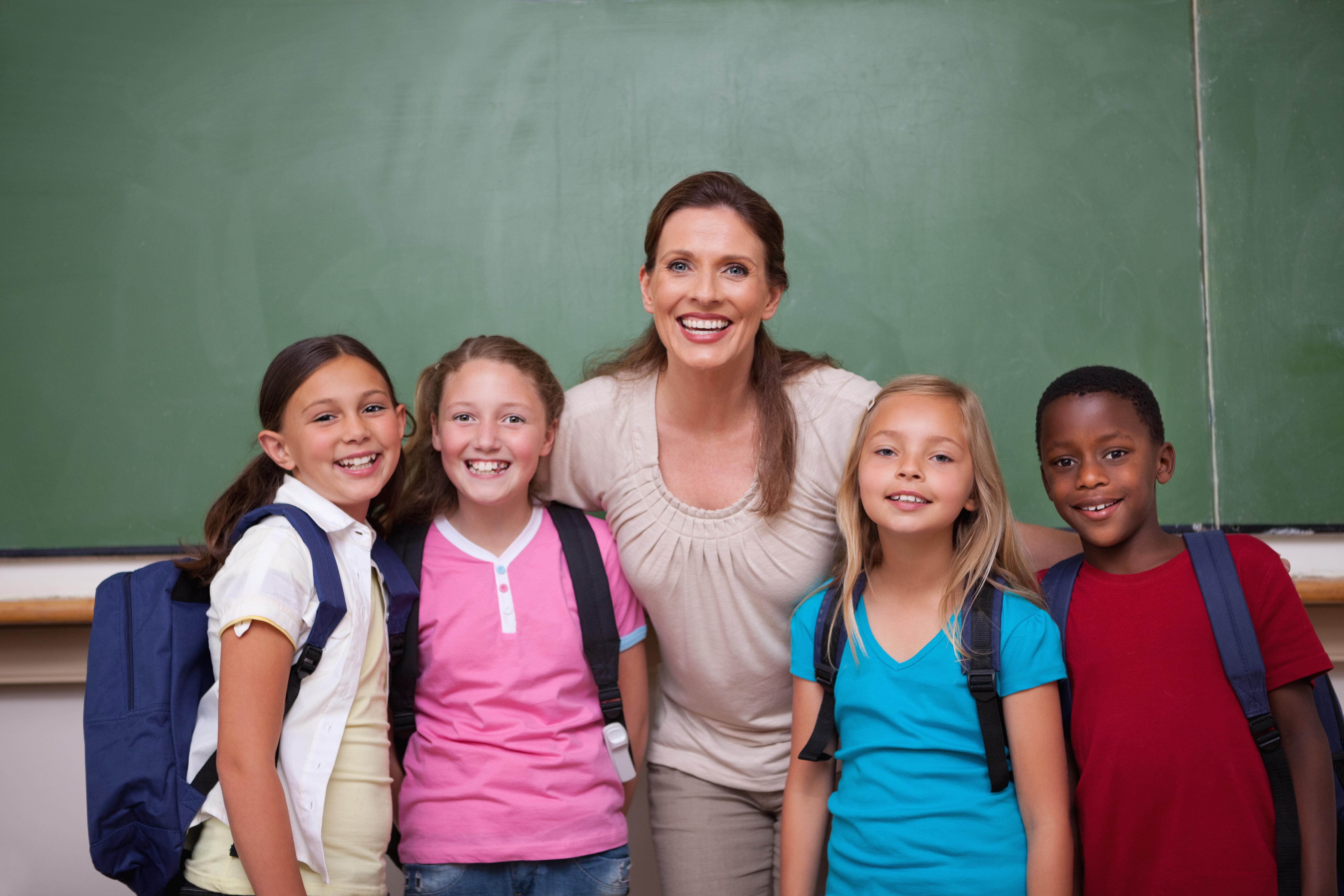 Schoolteacher posing with her pupils
